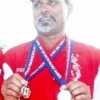 Gino Mourin, with his Bronze & Silver Medals