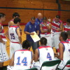 Sid Guzman discuss game plan with the team