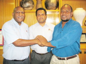 Deal sealed: TFPNG President Joe Yore, Patron Leon Buskens & Finance Director  John Melvin deal sealing