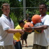Ryan Burns donating basketballs on behalf of the Pohnpei Basketball Association to teacher Rememster Johnna