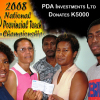 PDA owner Daisy Apore (with glasses) presents K5000