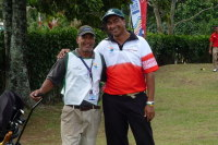 Atoloto with his caddy Mooshoo