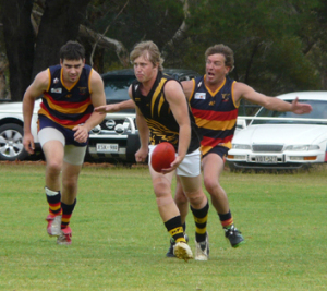 Rd 4 - BDT v LAM : Damian Stott of BDT about to lay a tackle on Craig Altus of Lameroo in the B grade.