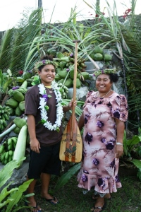 FSM Swimmer Debra Daniel and FSM Swim Coach Sweeter Daniel pose at the 2010 Pohnpei Liberation Day Games.  Debra carries her award for overall best female athlete at the 7th Micronesian Games held in Palau.