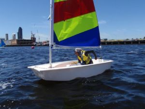 Khadija sailing the opti