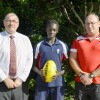 Bishop Druitt College student Kaman Malou will be representing NSW/ACT in the All Nations Cup to be played in Coffs Harbour. Kaman is pictured with school principal Alan Ball and AFL Northern NSW regional manager Rb McKelvie. Photo: Brad Palmer - Bishop D