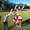 The Cancer Council's Lauren Dale hams it up with Coffs Swans players Mark Wilcox, Nic Von Schill, Pat Curtain in their special guernseys to commemorate this weekend's Cancer Awareness round. Photo: Trevor Veale / Coffs Coast Advocate