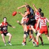 Sawtell/Toormina's Mark Couzens gets a handball away under pressue from his Coffs Swans opponents. Photo: Leigh Jensen / Coffs Coast Advocate