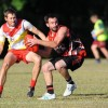 Sawtell/Toormina midfielder Luke Benson tries to escape the close attention of his Coffs Swans opponent at Fitzroy Oval. Photo: Leigh Jensen / Coffs Coast Advocate