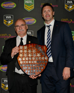 Bruce Greenwood accepts the Club Championship Shield from forner Western Red, Barry Jon Mather