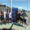 3x3 participants posing by sponsors banner