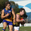 Travis Dean (right) playing for the Werribee Districts in 2014.