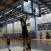 Devon McGee dunks against Zodiacs 3