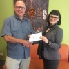 Brad Tallon, Chairman SEQ Division presenting cheque to Micah Projects